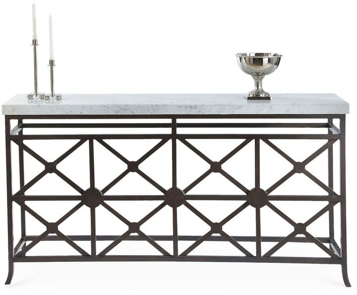 Showcasing impressive fretwork, this eye-catching console is crafted of bronze and topped with a swirling marble veneer. Sealed in an umber finish. Furniture > Tables > Console Tables.