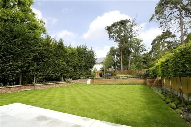 Professionally landscaped with full irrigation to the borders and lawn