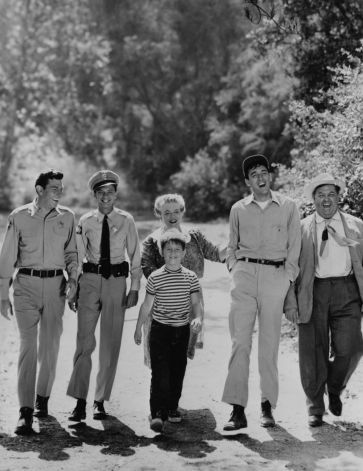 """EXCLUSIVE IN YOUR CITY -- ON THEIR WAY .... The most famous residents of Mayberry, U.S.A., are on their way back for the fourth season of """"The Andy Griffith Show."""" debuting Monday, Sept. 30 at 9:30-10:00 PM, EDT, over CBS-TV. They are (left to right) Andy, Don Knotts, Ronny Howard, Frances Bavier, Jim Nabors, and Hal Smith.  HOUCHRON CAPTION (02/04/1985):  """"The Andy Griffith Show"""": Books celebrate the show starring, from left, Andy Griffith, Don Knotts, Ron Howard, Frances Bavier, Jim Nabors…"""