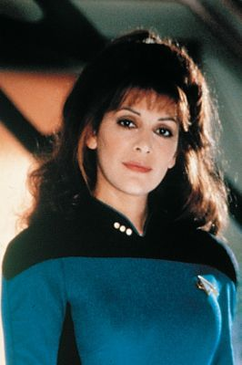 Marina Sirtis as Deanna Troi.  Liked this outfit so much more than the early 'bunny suits.'