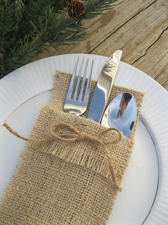 burlap silverware holder $6 for 4 from SplendidEvents on etsy.com but I bet they would be easy to make.