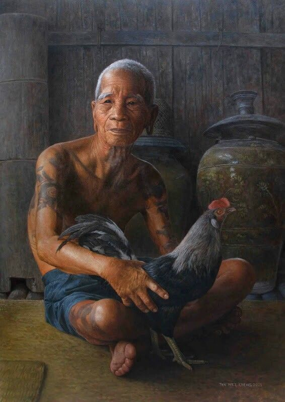 Iban man with fighting cock by Tan Wei Kheng,Sarawak,Malaysia