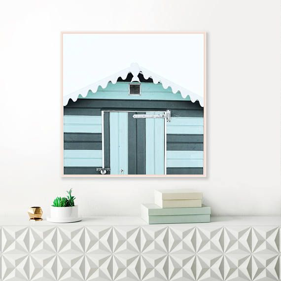 A Striking Beach Hut Print With Pale And Deep Blue Tones That You