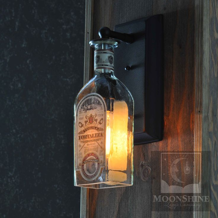 A wall sconce made from a recycled Fortaleza Tequila bottle.