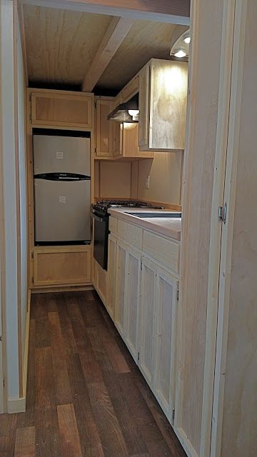 Beautiful galley kitchen -This is the Brighton 8′ 6″ x 24′ THOW by Molecule Tiny Homes for sale in Santa Cruz, California. Built on a gooseneck trailer, this bright yellow beauty includes a shed-style roof…