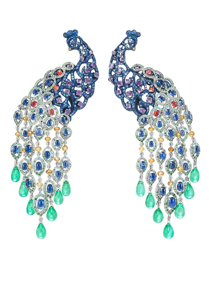The peacock's elegant blue titanium and gem-set body, suspending a delicate open-work fan of feathers, set with emerald, tsavorite and sapphire detail.