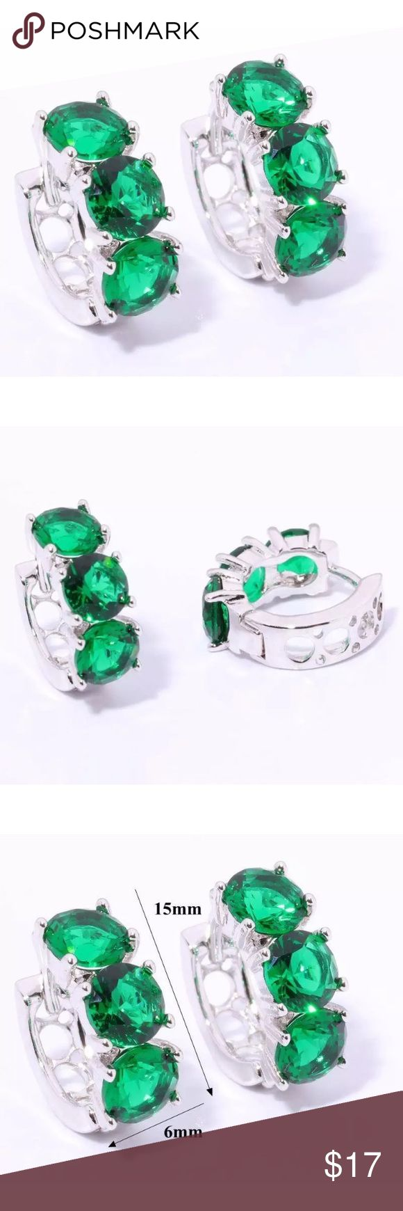Green Quartz & Silver Filled Huggie Earrings Green Quartz and silver filled huggie earrings. Gemstones are 5mm in diameter, 3 stones per earring. Earrings are 15mm in length. Please see photo #5 for information concerning silver filled vs. silver plated. Boutique Jewelry Earrings