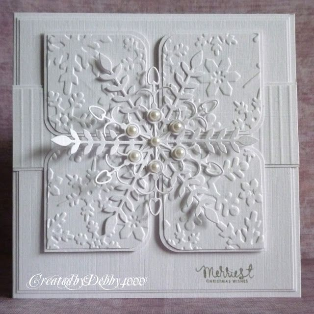 Embossing folder is a Sizzix and the Snowflake is a Memory Box one called Tivoli and the other one is Simon Says Stamps Faceted Snowflake.