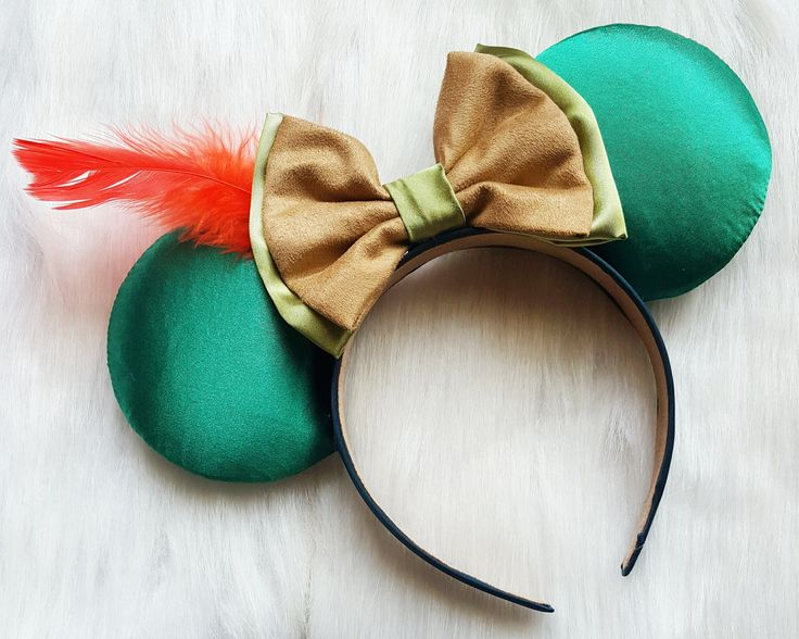 Peter Pan Inspired ears. Made out of satin and a red feather.  Turnaround for all ears is 7-10 days plus shipping 2-5 days. Unless told otherwise.  Plan ahead (:  I only ship within the United States as of right now.