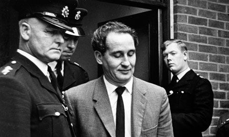 Ronnie Biggs, one of the Great Train Robbers, in police custody in 1963.