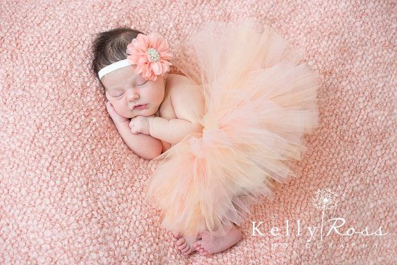 This little tutu is done in two tones of peach for the perfect blend. The matching headband is a peach, fabric flower with a gorgeous center made