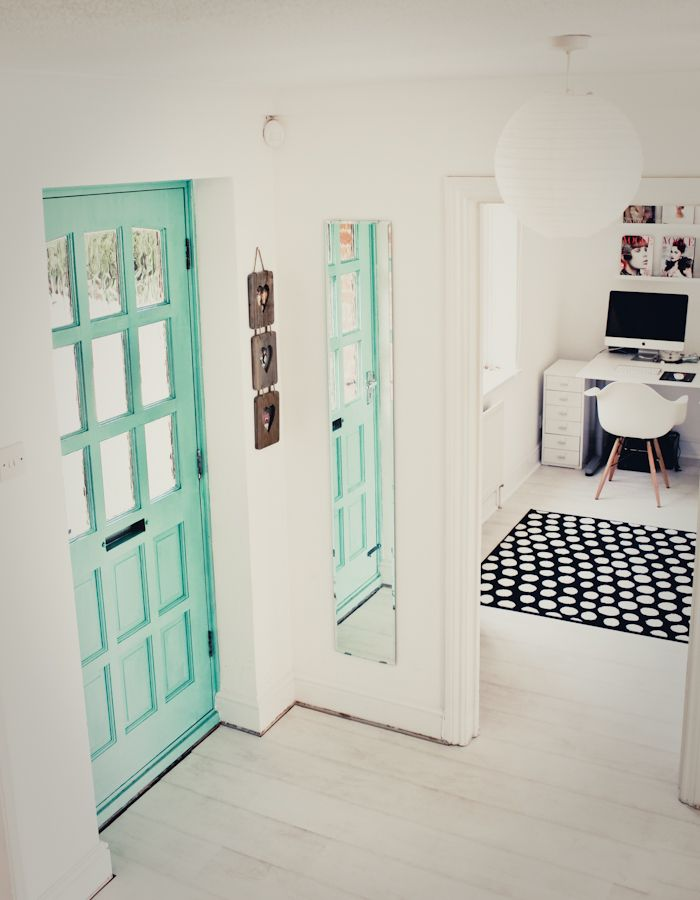 Turquoise door and white floors