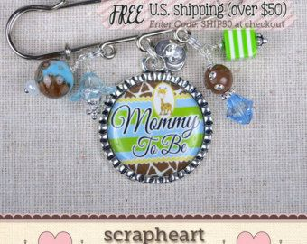 **FREE Shipping on US orders over $50. Enter code SHIP50 at checkout.** ~~~~~~~~~~~~~~~~~~~~~~~~~~~~~~~~~~~~~~~~~~~~~~~~~~~~~~~~~~~~~~~~~~~~~~~~~~~~~~~~~~~~ These sweet personalized baby pins make a very special keepsake gift for the new Mom, Grandma, Great Grandma or Aunt. If youre planning a Baby Shower and looking for that extra special personalized gift, these pins are the perfect thing for you!  ・Personalize with any name, title, or to-be! Enter details at checkout. ・Comes with…