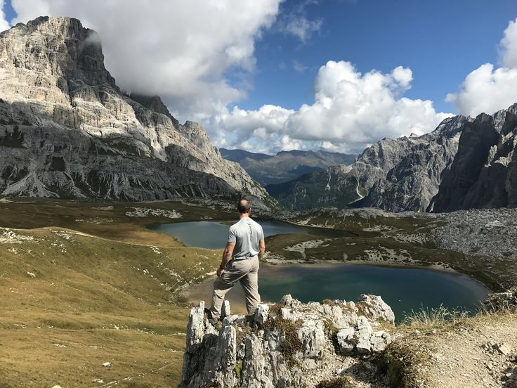 Surveying the awesome views above some alpine lakes in the Dolomites.