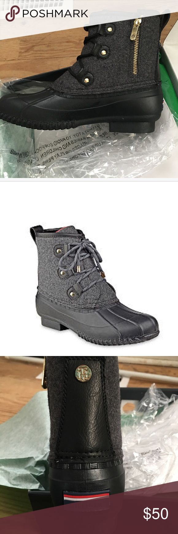"""Tommy Hilfiger charcoal classic duck boots. NIB. Get ready for April showers with this pair of classic duck boots by Tommy Hilfiger.  Style is Reanna and tops are charcoal gray fabric with leather back strip and foot and bottoms are black rubber.  New in box.   * Manufacturers measurements:  1"""" heel; 6"""" shaft height; 10"""" calf circumference * Round toe * Lace-up and zip closure Tommy Hilfiger Shoes Winter & Rain Boots"""