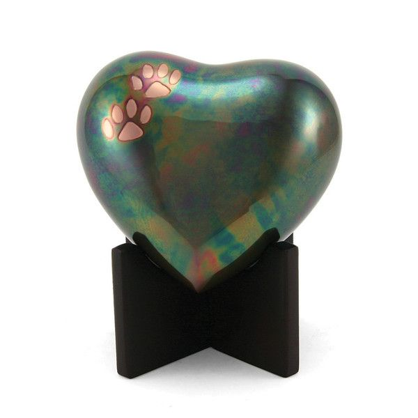 - Raku heart cremation urns for pets with paw prints accents. Handmade from sand cast brass that was heated in the oven to create the rainbow raku effect. Beautiful and durable. - Not all urns will be