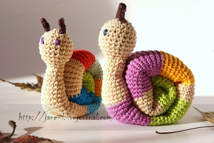 Handmade crochet knitted snails. Cotton yarn, wooden bead in the head