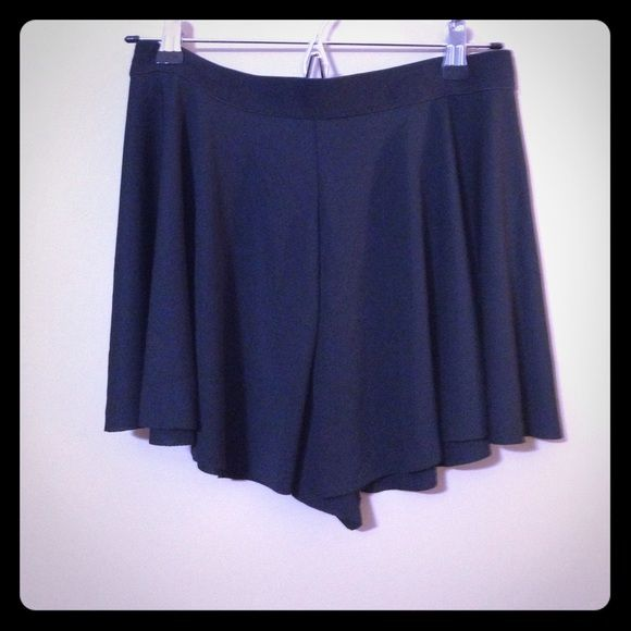 Flowy black shorts Black shorts with elastic waist that look like a skirt when worn! Perfect for summer or festivals when you're on the go and don't want to worry about wearing a skirt! Shorts