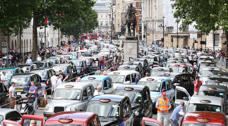 Taxis blockade Whitehall in London on 11 June, in protest against the Uber taxi app  Photograph: Peter Macdiarmid/Getty