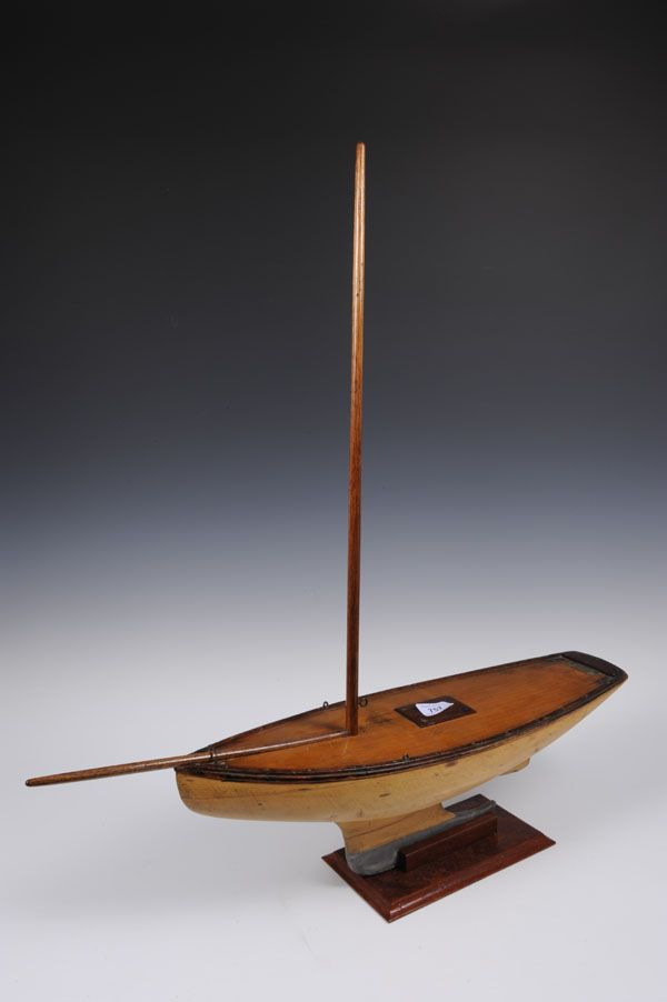 1930s wood and lead keel pond yacht with mahogany deck and Gamages London label on stand, 72cm high