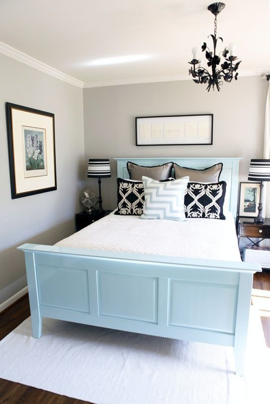 Oh this is a GREAT idea for a small master bedroom!...different colors though, grey and coral with bed in white or black.
