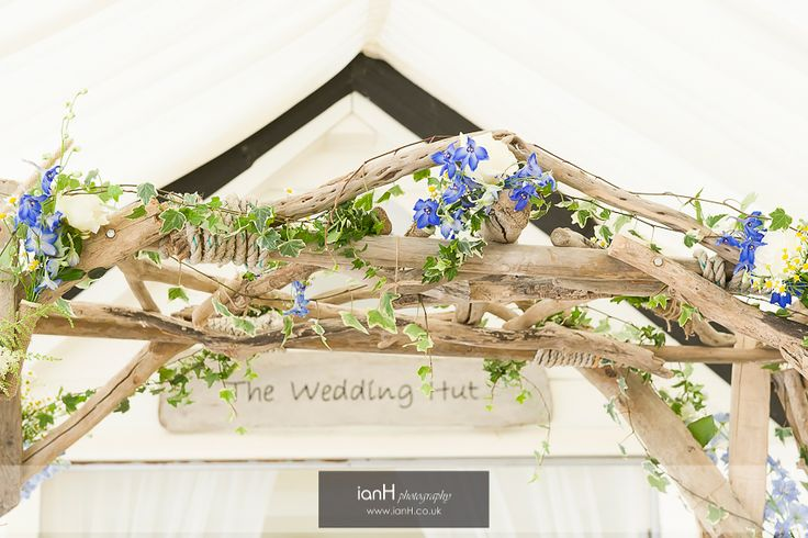 Floral arch by Arcade Flowers at a beach wedding © ianH photography