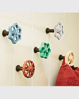 Quirky faucet knobs make great wall hooks for anything you might need to hang up in your sunroom from sweaters to bags to curtains. Love the vintage farmhouse appeal! Bathroom or laundry room