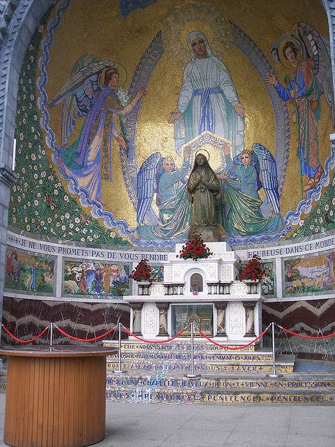 Altar of St Bernadette, Lourdes, France: This is to the left as you look at the Rosary Basilica at Lourdes. Under the altar, protected by glass, is the reliquary containing an arm bone of St Bernadette.