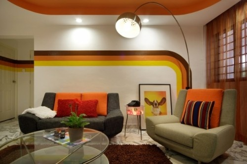 Remember those rainbow bumper stickers everyone used to have on their cars? This '70s-inspired rainbow wall and arc lamp look perfect for a game room or basement hangout. The comfy chairs are perfect for relaxing with friends while playing a couple rounds on an Atari.