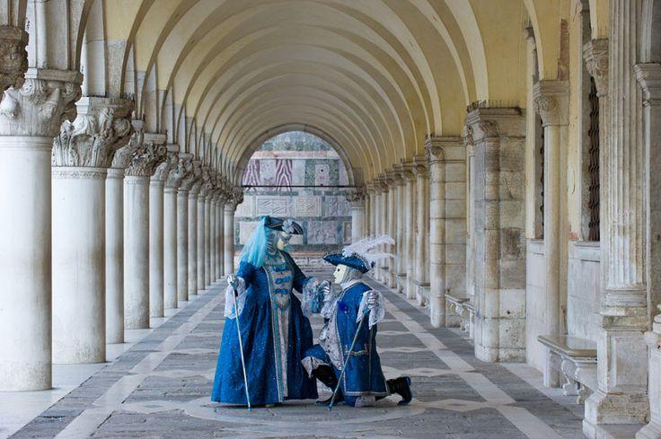Traditionally-attired carnival revellers pose in Venice  Picture: Marco Secchi / Barcroft Media