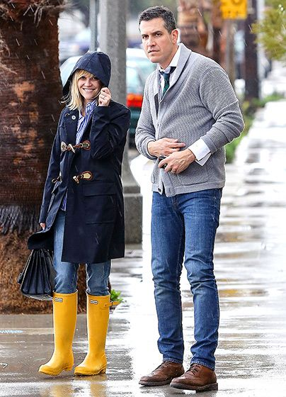 Rainy Reese - Reese Witherspoon and her husband Jim Toth bundled up in the rain while leaving AXE Restaurant.