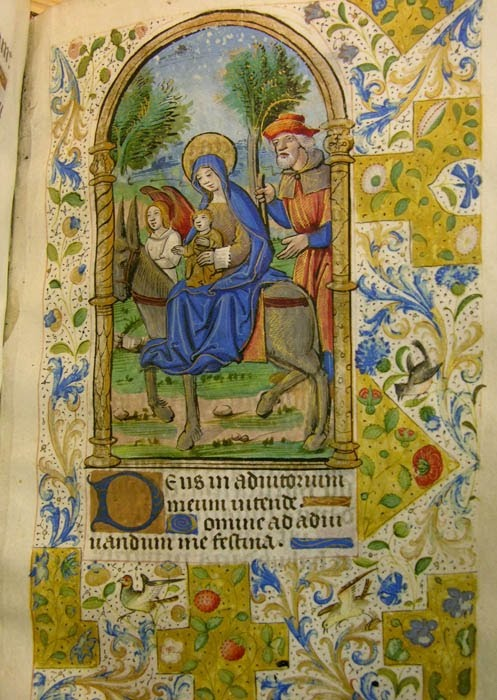 """The Flight into Egypt, Book of Hours, France, 1490-1500: """"I learned that the style of its miniatures included both medieval and renaissance elements. In the 'Flight into Egypt' miniature above, both are shown: the renaissance in the architectural surround, and the medieval in the enchanting border.""""  Altoon Sultan  on his great blog"""
