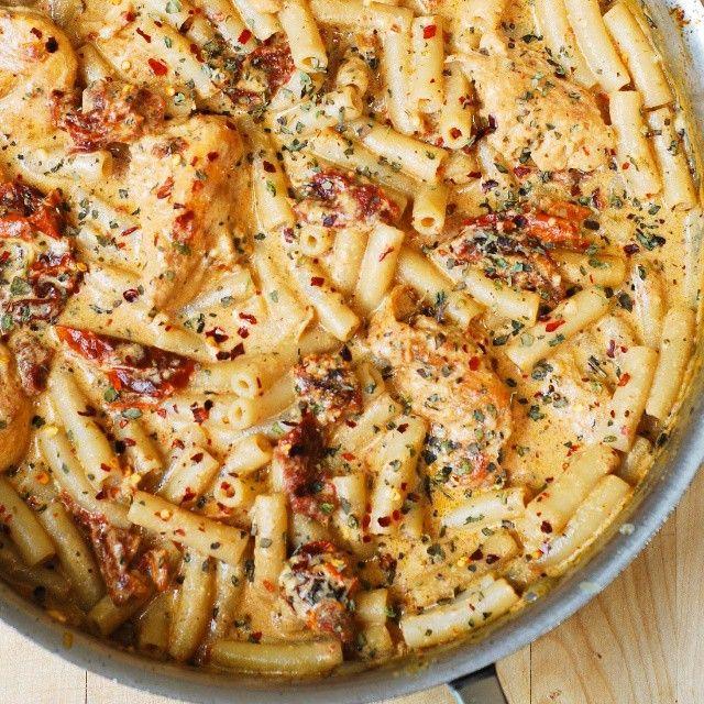 Chicken pasta in sun dried tomato creamy sauce (with basil, crushed red pepper flakes). Perfect dinner!  Recipe on JuliasAlbum.com  #dinner #pasta #penne #chicken #photoyum #instantyum #sundried #creamy #cheesy #glutenfree #brownricepasta #chickenpasta #juliasalbum