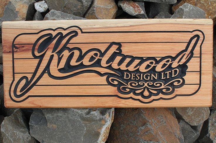 Macrocarpa sign V carved