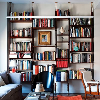 Industrial bookshelves inspiration (good ratio of books and art).