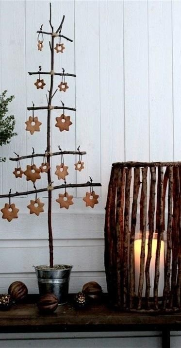 Simple stick tree for hanging Christmas ornaments.