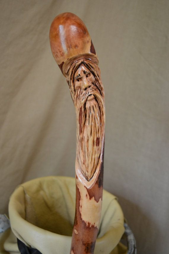 Walking cane carved wood spirit face hand