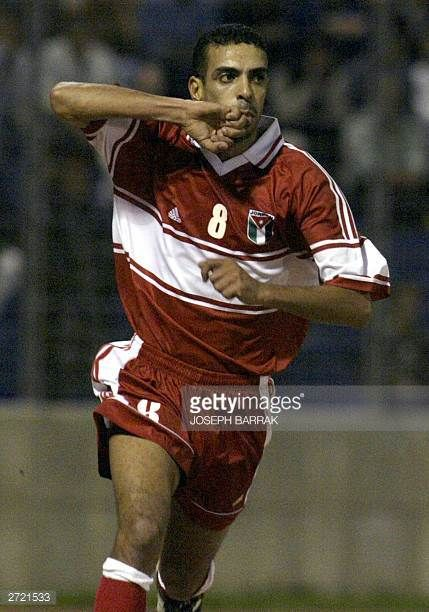 Jordanian player Hassun alSheikh jubilates after scoring a goal in the Lebanese net during the two national teams' Asian CupChina 2004 qualifying...
