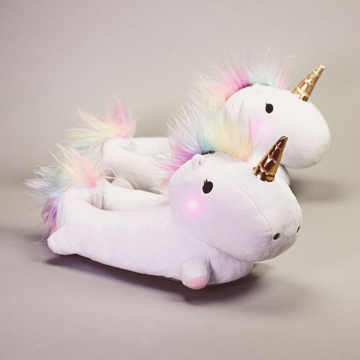 At last, the undeniable cosiness of slippers has collided beautifully with the colourful magic of a mythical steed. These Enchanted Light-Up Unicorn Slippers