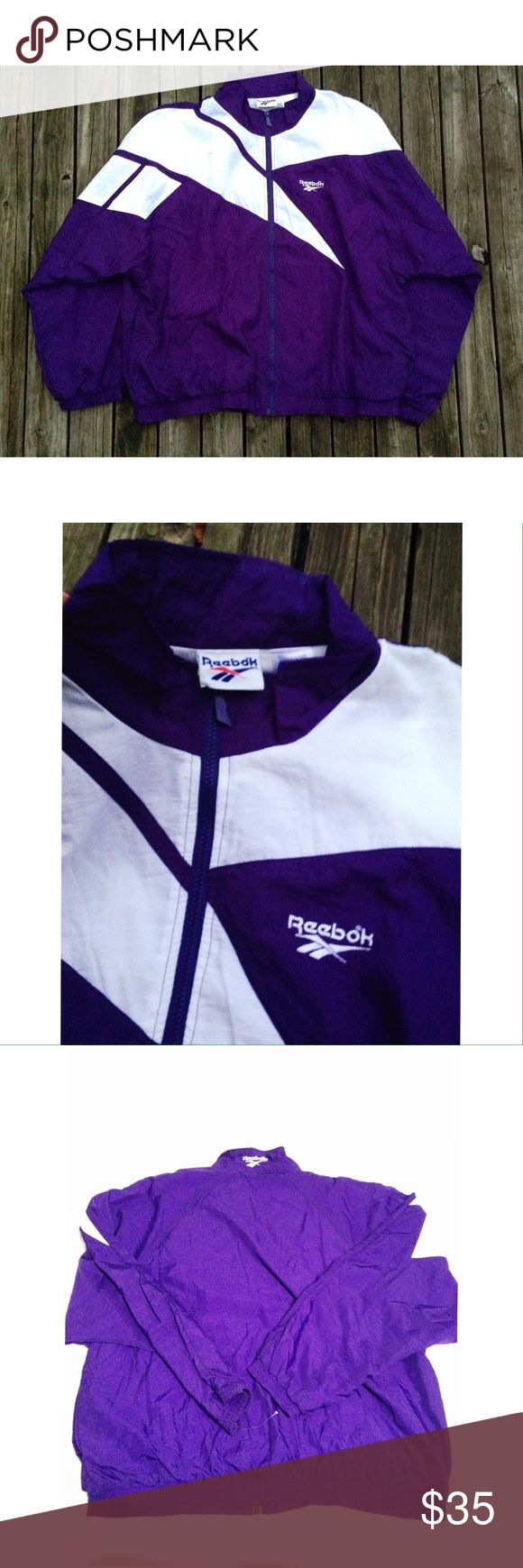 Vintage Reebok windbreaker Woman's size XXL or fits a men's size XL. New windbreaker without the tags. Rare vintage windbreaker in excellent condition. Purple with white design. Nice classic windbreaker. Vintage Reebok. Retro Reebok Jackets & Coats