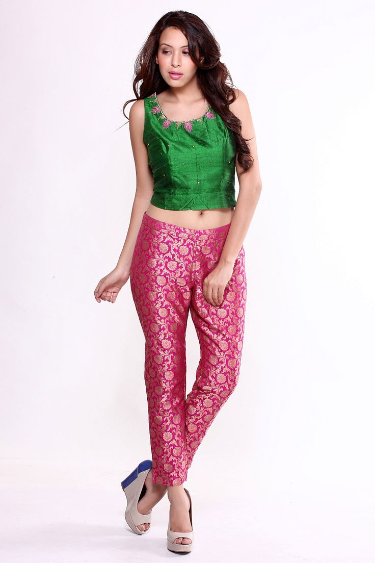 Hot pink brocade cigarette pantswith an Indian touch perfect for the gypsy heart inside you. Can be teamed up with kurtis, tunics, tops, blouses, sheer jackets / wrap-arounds. Great for formal or semi-formal evenings. Can be made fitted or straight-cut. Wear with wedge heels or platforms for that oomph factor.  Fabric: Silk Brocade