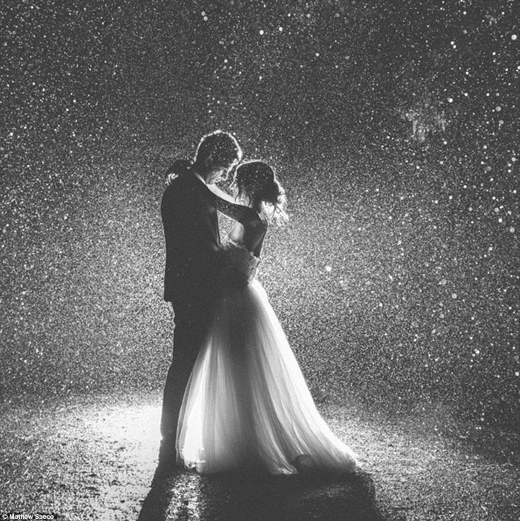 Clear skies are overrated: One snap shared showed a couple embracing as rain poured down around them - no umbrella necessary