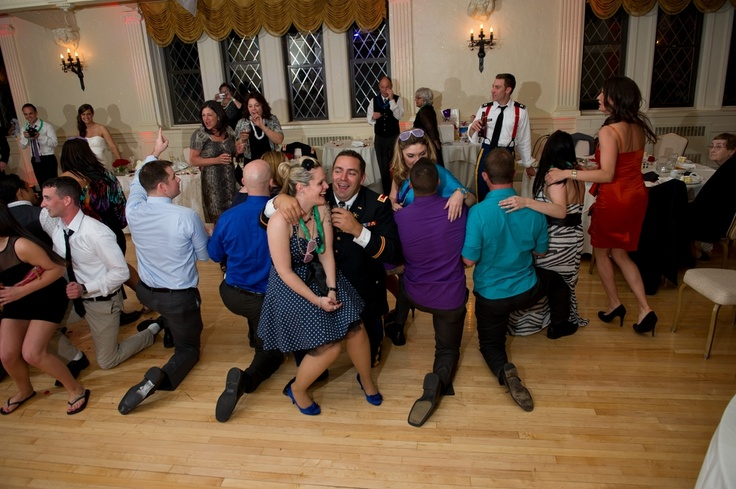 Fun game for a  wedding reception! Musical chairs where the guys legs are the 'chairs!'