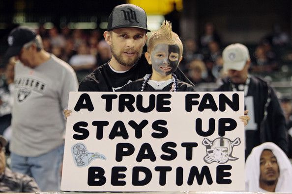 A young Oakland Raiders fan holds up a sign indicating the late 8:35 pm PT start for their game against the San Diego Chargers on October 06, 2013 at O.co Coliseum in Oakland, California.