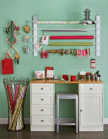 Start with a free spot in the garage or a guest room; install some Pegboard and a rack for paper and ribbons (we found all the materials at the Home Depot); add a desk (one with drawers is ideal), a stool that tucks under the desk when not in use, and a variety of storage containers -- and you're ready to wrap.