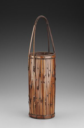 "Iizuka Rokansai (Japanese, 1890-1958): ""Bamboo Grove"" (Chikurin) Basket, Showa era, c. 1945, inner layer: dyed madake bamboo; outer layer: susudake smoked bamboo, finished with dust and lacquer. Museum of Fine Arts, Boston."