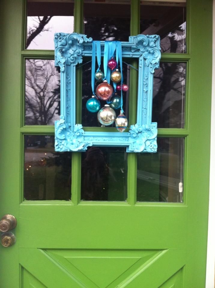 Old frame, spray paint, vintage ornaments, ribbon and hot glue!  Holiday door decor that's not a wreath!!!