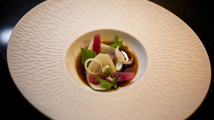 """Onion bowl   """"This recipe belongs to chef James Knappett and his hidden restaurant in London, called Kitchen Table. It's tucked away at the back of Bubbledogs – a Champagne bar run by his wife. Every evening, James and his team prepare a menu to represent the best products of the day. The title of this dish is 'Onion bowl', however, it is much more than just a bowl of onions. This is a Michelin Star bowl of onions!""""Luke Nguyen,Luke Nguyen's United Kingdom"""