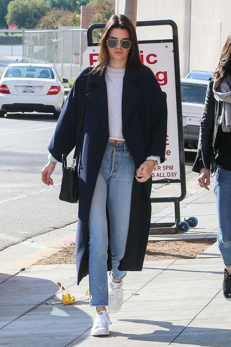 Kendall Jenner | white short shirt + high-waisted straight light wash jeans + Stan smith sneakers + navy long coat