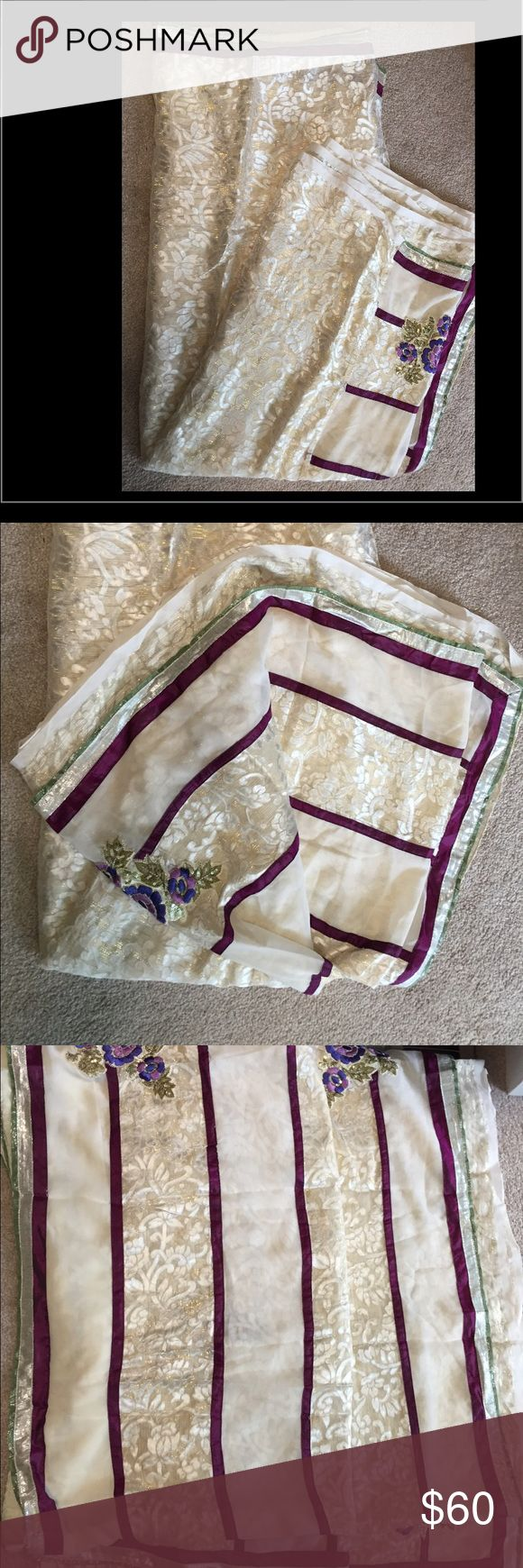 Bollywood saree White really light weight brasso sari with purple flower n stripe on half...wore it one time only. With blouse $50 Other
